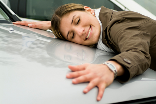 Women Hugging Car
